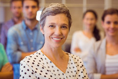 Creative businesswoman smiling at the camera Stock Photos