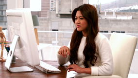 Creative businesswoman typing on computer stock footage