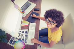 Creative businesswoman typing on laptop Royalty Free Stock Photography
