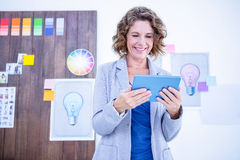 Creative businesswoman using tablet computer Royalty Free Stock Images