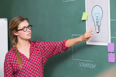 Creative businesswoman at work by blackboard Royalty Free Stock Images
