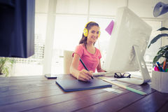 Creative businesswoman writing on a tablet Stock Photo