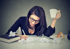 Creative busy woman working at her desk. Creative busy young woman working at her desk Royalty Free Stock Photography