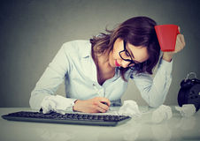 Creative busy woman working at her desk Stock Images
