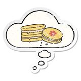 A creative cartoon biscuit and thought bubble as a distressed worn sticker. An original creative cartoon biscuit and thought bubble as a distressed worn sticker vector illustration