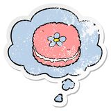 A creative cartoon biscuit and thought bubble as a distressed worn sticker. An original creative cartoon biscuit and thought bubble as a distressed worn sticker royalty free illustration