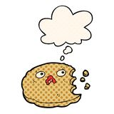 A creative cartoon bitten cookie and thought bubble in comic book style. An original creative cartoon bitten cookie and thought bubble in comic book style royalty free illustration