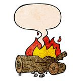 A creative cartoon camp fire and speech bubble in retro texture style. An original creative cartoon camp fire and speech bubble in retro texture style royalty free illustration