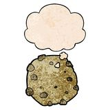 A creative cartoon cookie and thought bubble in grunge texture pattern style. An original creative cartoon cookie and thought bubble in grunge texture pattern stock illustration