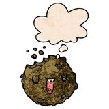 A creative cartoon cookie and thought bubble in grunge texture pattern style. An original creative cartoon cookie and thought bubble in grunge texture pattern royalty free illustration