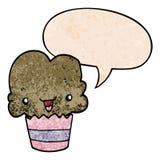 A creative cartoon cupcake and face and speech bubble in retro texture style. An original creative cartoon cupcake and face and speech bubble in retro texture stock illustration