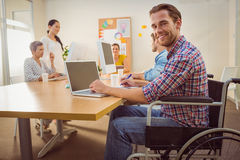 Creative casual businessman in wheelchair Stock Image