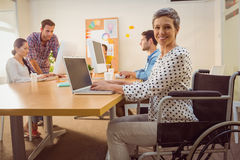 Creative casual businesswoman in wheelchair Stock Photo