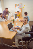 Creative casual businesswoman in wheelchair Stock Photo