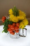 Creative centerpiece with vegetables and foliage Stock Photos