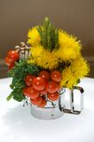 Creative centerpiece with vegetables and foliage Royalty Free Stock Image