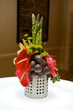 Creative centerpiece with vegetables and foliage Royalty Free Stock Photo