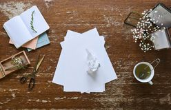 Creative chaos individual workspace vintage atmosphere. Paper royalty free stock photography