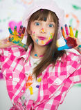 Creative child concept. Playing with colors.  Beautiful children with colorful hands, creative child concept Stock Photo