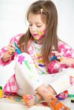 Creative child concept. Portrait of a cute cheerful happy little girl showing her hands painted in bright colors stock photography
