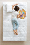 Creative child falling asleep with his palette Stock Photos