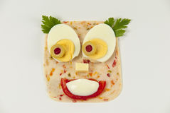 Creative child food. Creative childfood from salami, tomato, eggs, olive, cheese and parsley Stock Photography
