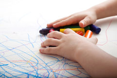Creative Child Gathering Colors. Child is gathering up colors on top of creative drawings royalty free stock images