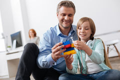 Creative child and her dad building something together Stock Images