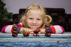 Creative child with home made autumn craft Stock Photo