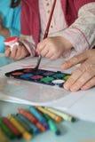 Creative child painting Stock Image