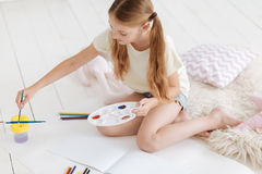 Creative child painting at home Royalty Free Stock Images