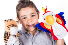 Creative child with puppets. Creative and happy child with puppets Stock Images