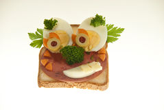 Creative childfood 4. Creative childfood from salami, tomato, eggs, olive, cheese and parsley, broccoli, toast Royalty Free Stock Photo