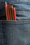 Creative children, coloured pencils in the pocket Royalty Free Stock Image