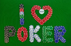 Creative chips, I love poker. Colored chips that make up the inscription I love poker with button inside of heart Stock Photos