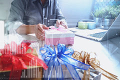 Creative choosing gift with laptop computer and smart phone on m Royalty Free Stock Photo