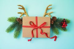 Creative Christmas background with gift box and reindeer horns stock image
