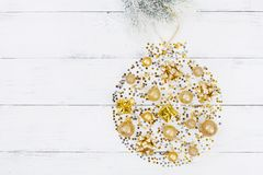Creative christmas background of holiday ball with decoration and confetti top view. Flat lay. stock photography