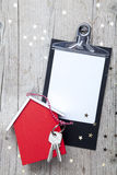 Creative Christmas Background with a key and a new house Royalty Free Stock Images