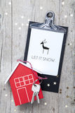 Creative Christmas Background with a key and a new house Stock Photography