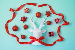 Creative Christmas background with reindeer and decorations royalty free stock image