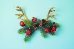 Creative Christmas background with reindeer horns stock photography
