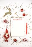 Creative Christmas composition with notepad and decorations. stock images