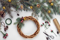Creative christmas diy. Woman making handmade xmas wreath. Home leisure, tools, trinkets and details for holiday. Decorations on white table background. Top royalty free stock photos