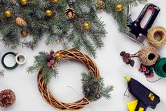 Creative christmas diy. Woman making handmade xmas wreath. Home leisure, tools, trinkets and details for holiday royalty free stock photo