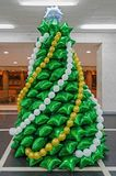 Balloons in form of Christmas tree. Creative Christmas tree made of inflatable balloons of green color in the hall of the Opera House stock photos