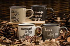 Creative, Coffee Mugs with Text on a Background Created by Leave Stock Photo