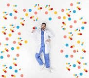 creative collage of handsome young doctor lying on white surrounded royalty free illustration