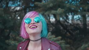 Creative girl with blue and pink dyed hair stock footage