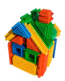 Creative colored block toy house. With clipping path on a white bnackground Stock Photos